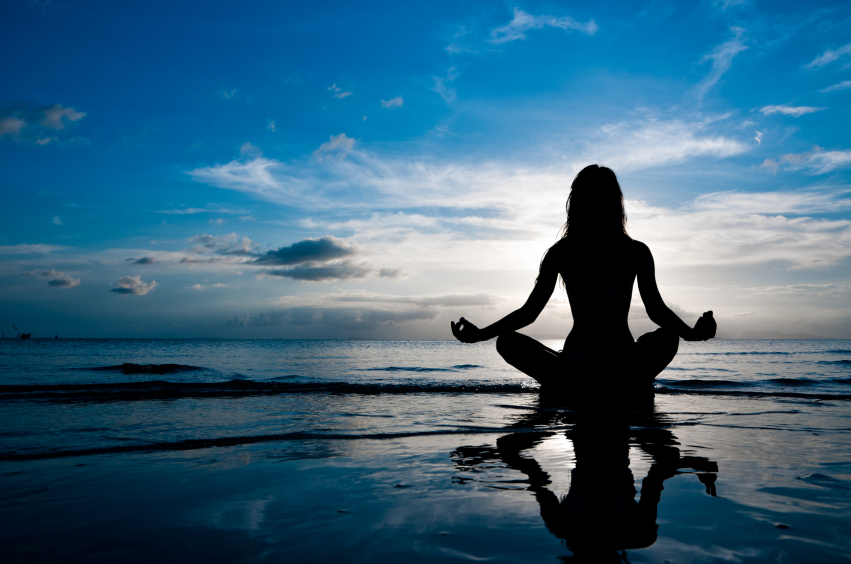 woman-meditating-ocean