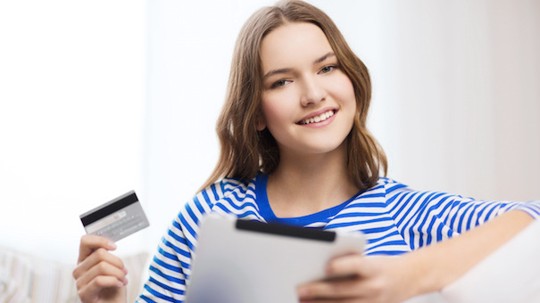 smiling girl with tablet pc and credit card - F2 Fitness